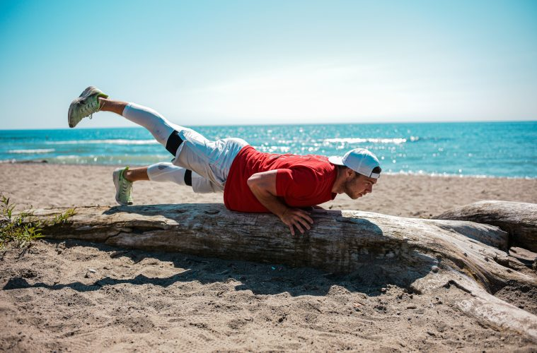 Adam Goldstein working out on the beach