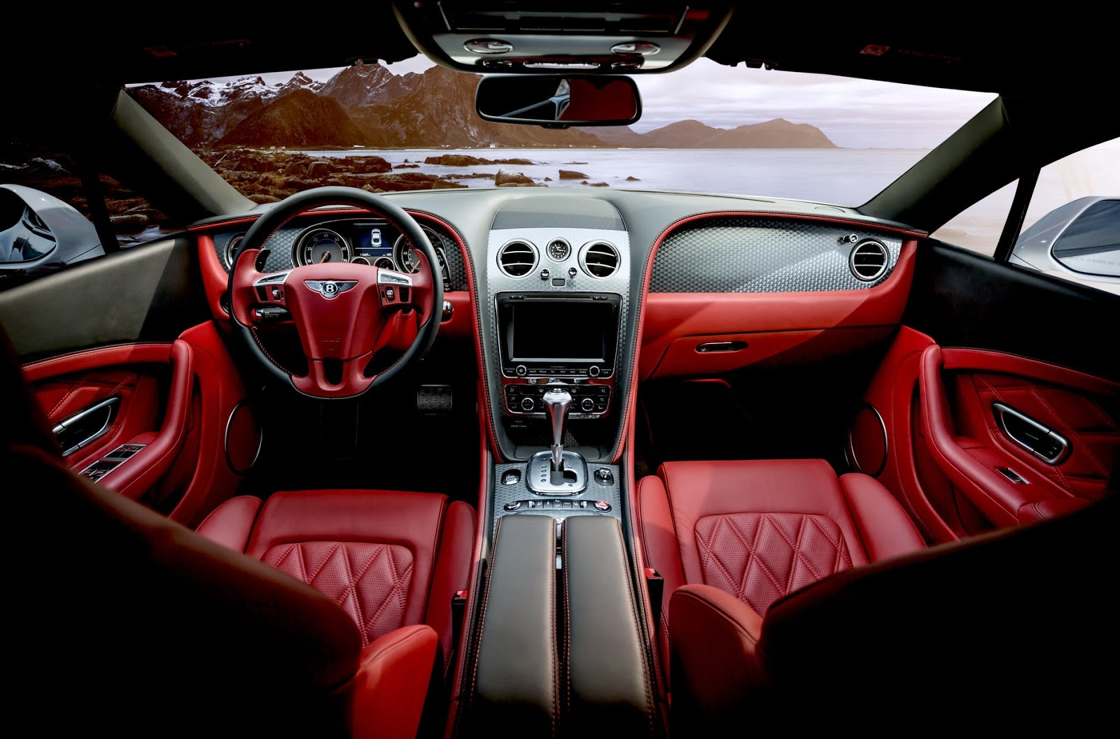 the interior of a luxury car, it's also red