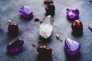 meditation and healing crystals in pink, pruple, and tigers eye or orange