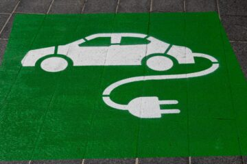 electric car logo with green and spray paint