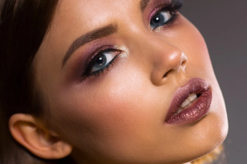 a gorgeous young woman with nice make up on